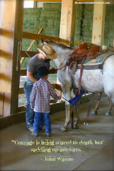 Libby saddling horses