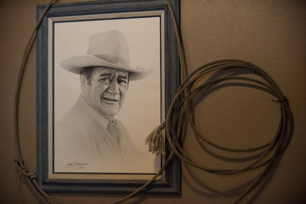 Photo of drawing of The Duke John Wayne with rope around the frame