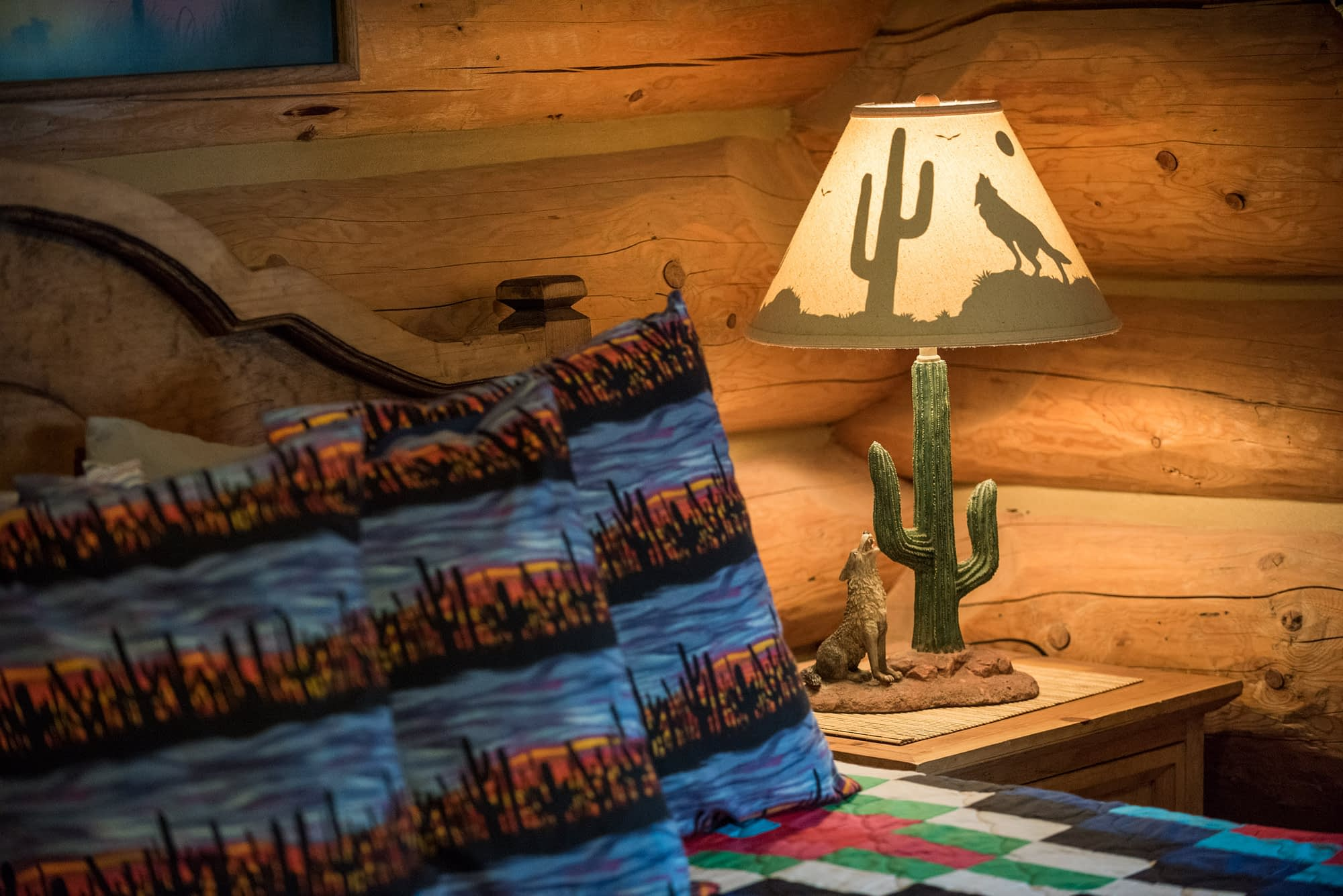 Western Pleasure Guest Ranch Siesta Room bed with pillows and cactus lamp