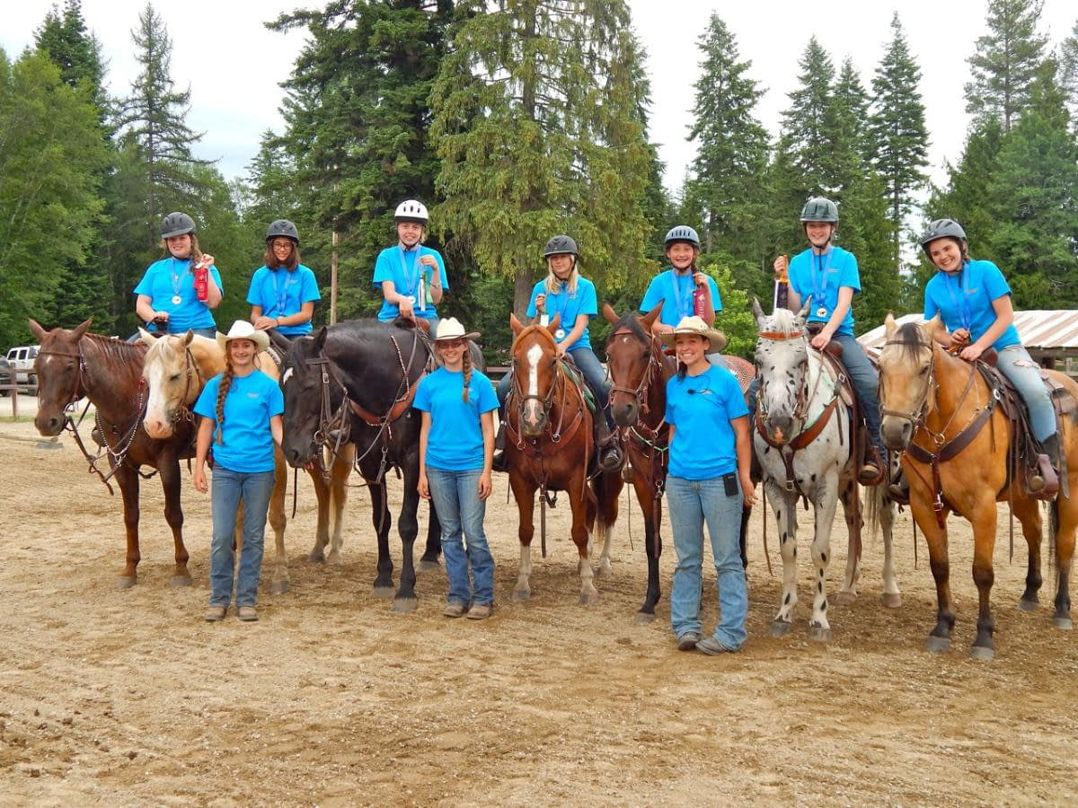 kids on horses lined up in an arena at Western Pleasure Guest Ranch Youth Horsemanship program