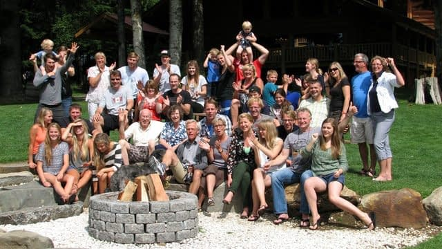 Large Family Reunion group standing behind a fire pit