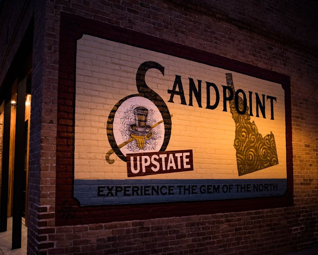 Sign on brick wall of Sandpoint, Idaho