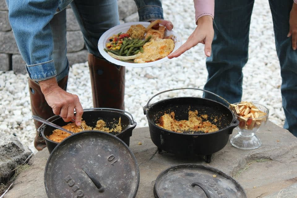 dutch oven pots filled with food