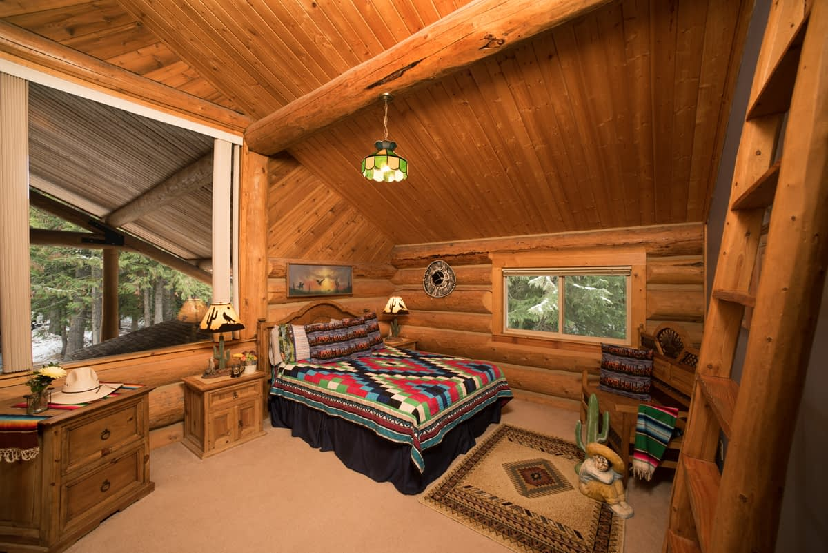 Southwestern style room with log walls rustic wood furniture