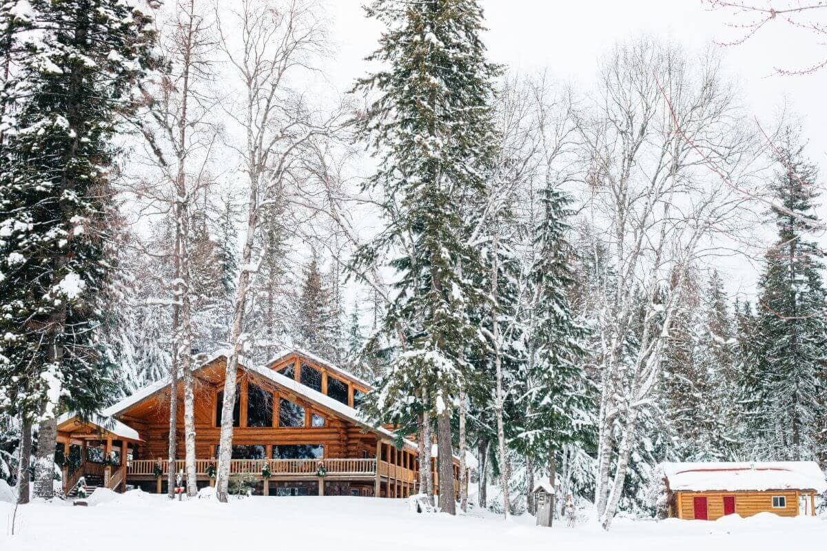 Log lodge and log cabins at Idaho dude ranch in a snow covered forest