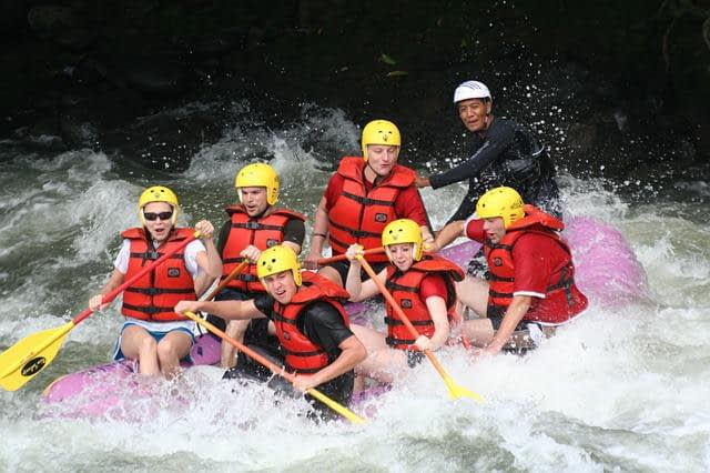 seven people in a raft White water rafting