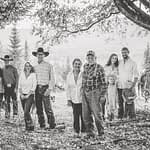 Western Pleasure Guest Ranch Family Photo in black and white family stands together under a tree